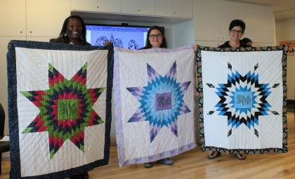 Quilts commemorating the Three Sisters Accord between the Toronto Birth Centre, Women's College Hospital, and Seventh Generation Midwives Toronto.