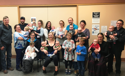 Dr. Ashley Dyson and Dr. Sahar Alhayjaa with a number of families that were able to deliver their twins at BTHC. Photo courtesy of Heather Coutts at Salus Global.